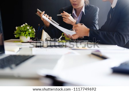Business Concept, Audit team working with tablet computer and paper report in finance office.
