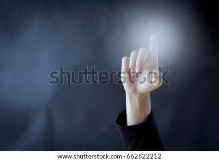 Business concept background of hand point over blurred dark background #662822212