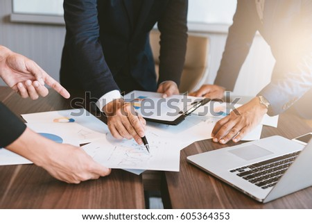business concept, Business man working and meeting with chart at office on his desk #605364353