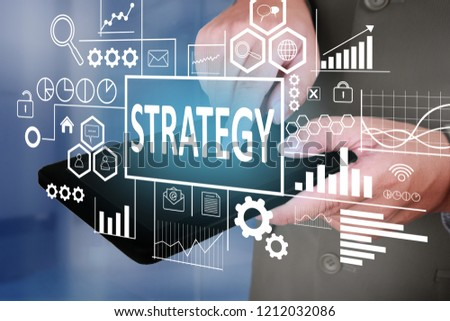 Business Concept. Businessman click strategy button on his tablet. Goals Text typography design #1212032086