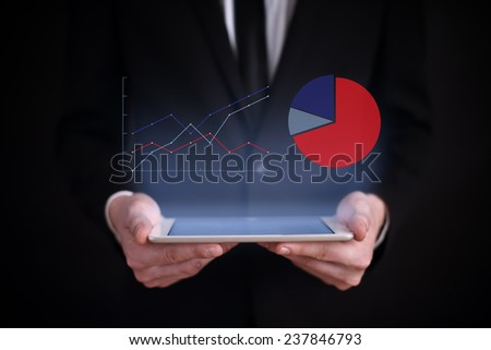 Businessman Hand Touch Screen Growth Chart On A Tablet