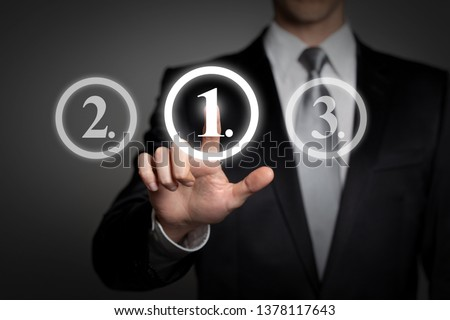 business concept - businessman in suit presses virtual touchscreen interface button - ranking first place #1378117643