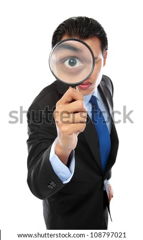 business concept - businessman looking through magnifying glass