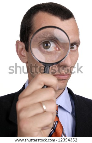 business concept - businessman with magnifying glass