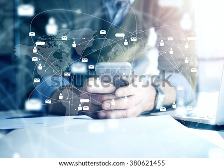 Shutterstock Business concept, businessman with smartphone. Worldwide connection technology interface, horizontal mockup.