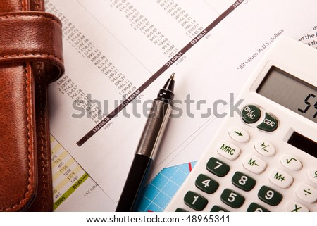 Business Concept, calculator pen and wallet