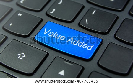 Business Concept: Close-up the Value Added button on the keyboard and have Azure, Cyan, Blue, Sky color button isolate black keyboard