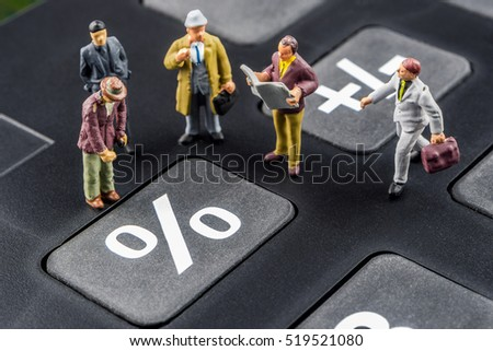 business concept, closeup of miniature figurine of businessmen discussing on big black calculator about interest rates / percentage changes Stock photo ©