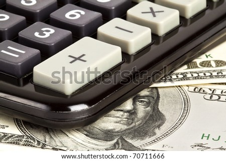 Business concept. Dollars; calculator;