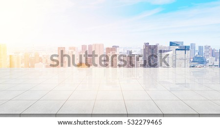 Business concept - Empty concrete floor top with panoramic modern cityscape building bird eye aerial view under sunrise and morning blue bright sky of Tokyo, Japan for display or montage product #532279465