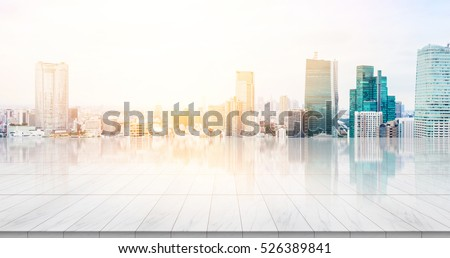 Business concept - Empty marble floor top with panoramic modern cityscape building bird eye aerial view under sunrise and morning blue bright sky of Tokyo, Japan for display or montage product #526389841
