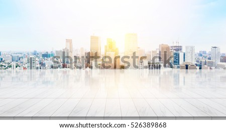 Business concept - Empty marble floor top with panoramic modern cityscape building bird eye aerial view under sunrise and morning blue bright sky of Tokyo, Japan for display or montage product #526389868