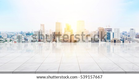 Business concept - Empty marble floor top with panoramic modern cityscape building bird eye aerial view under sunrise and morning blue bright sky of Tokyo, Japan for display or montage product #539157667