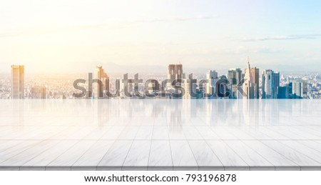 Business concept - Empty marble floor top with panoramic modern cityscape building bird eye aerial view under sunrise and morning bright sky of Tokyo, Japan, for display or montage product