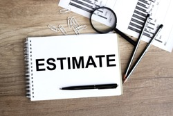 BUSINESS CONCEPT: ESTIMATE.on a white background on a wooden table