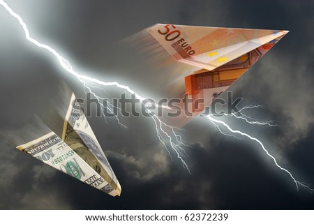 business concept. euro and dollar plane and  thunderstorm