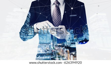 Business concept for information, communication, connection technology - double exposure effect of office man and panoramic modern city skyline bird eye aerial night view under dramatic dark blue sky #626394920