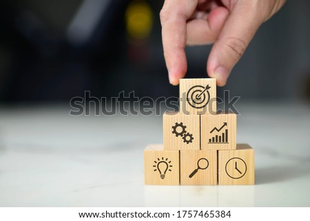 Business concept growth success process, Close up man hand arranging wood block with icon business strategy and Action plan, copy space. Foto stock ©