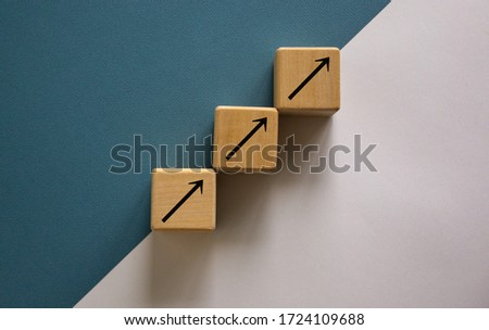 Business concept growth success process. Wood block stacking as step stair on paper blue and white background, copy space. Stock photo ©