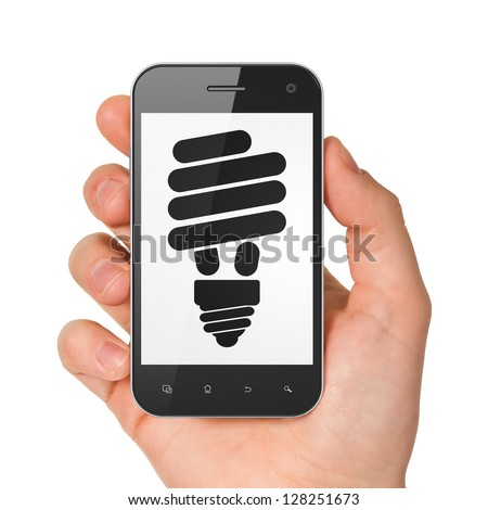 Business concept: hand holding smartphone with Energy Saving Lamp on display. Generic mobile smart phone in hand on White background.