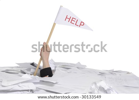 business concept: hand sticking out of desk full of papers with help flag