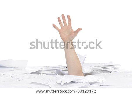 business concept: hand sticking out of papers on a desk