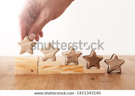 business concept image of setting a five star goal. increase rating or ranking, evaluation and classification idea #1451343140