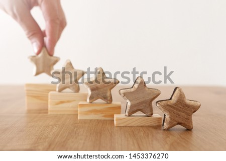 business concept image of setting a five star goal. increase rating or ranking, evaluation and classification idea #1453376270