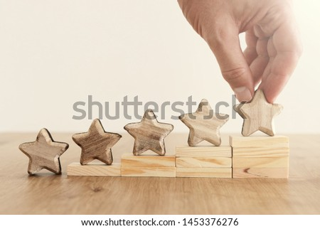 business concept image of setting a five star goal. increase rating or ranking, evaluation and classification idea #1453376276