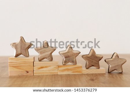 business concept image of setting a five star goal. increase rating or ranking, evaluation and classification idea #1453376279