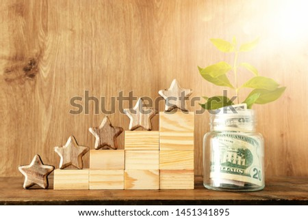 business concept image of setting a five star goal. increase rating or ranking, evaluation, money investment and financial growth concept #1451341895