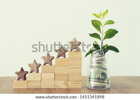 business concept image of setting a five star goal. increase rating or ranking, evaluation, money investment and financial growth concept #1451341898