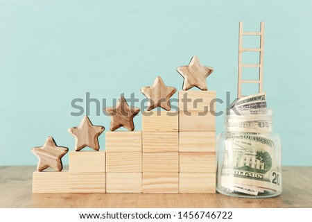 business concept image of setting a five star goal. increase rating or ranking, evaluation, money investment and financial growth concept #1456746722