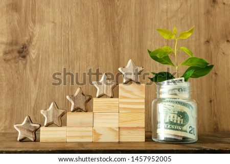 business concept image of setting a five star goal. increase rating or ranking, evaluation, money investment and financial growth concept #1457952005