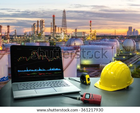 Business concept, industry. Laptop desk on with Oil and gas industry background