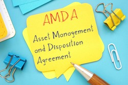 Business concept meaning Asset Management and Disposition Agreement (AMDA) with phrase on the sheet.