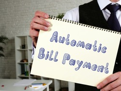 Business concept meaning Automatic Bill Payment with sign on the piece of paper.