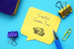 Business concept meaning Capital Gains Tax with sign on the piece of paper.