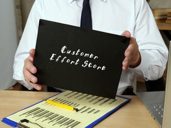 Business concept meaning Customer Effort Score with inscription on the page.