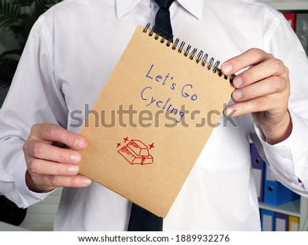 Business concept meaning Let's Go Cycling p with sign on the page. Stock fotó ©