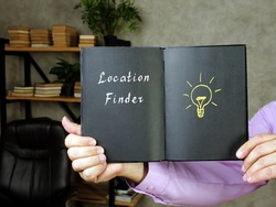 Business concept meaning Location Finder with sign on the piece of paper.