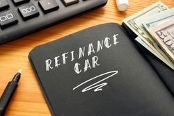 Business concept meaning REFINANCE CAR with inscription on the piece of paper.