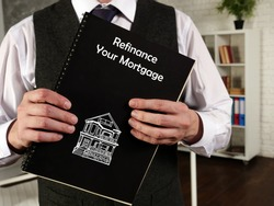 Business concept meaning Refinance Your Mortgage with phrase on the piece of paper.