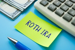 Business concept meaning ROTH IRA individual retirement account with phrase on the page.