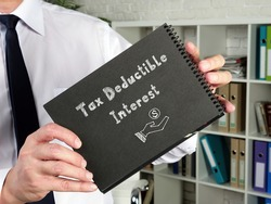 Business concept meaning Tax Deductible Interest with phrase on the piece of paper.
