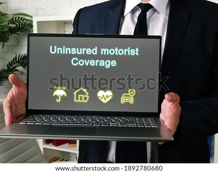 Business concept meaning Uninsured motorist Coverage with phrase on the page. Сток-фото ©