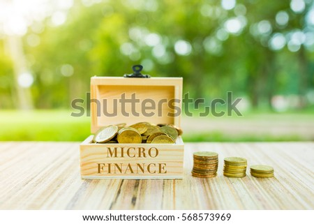 Business Concept :   MICRO FINANCE word on box over blur and sunlight background.