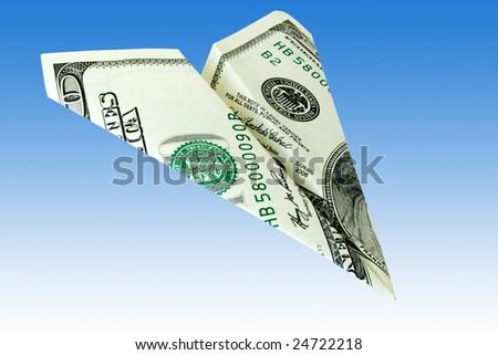 business concept. money plane over a blue background