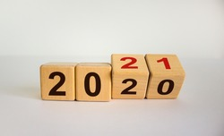 Business concept of planning 2021. Turned wooden cubes and changed the inscription '2020' to '2021'. Beautiful white background, copy space.