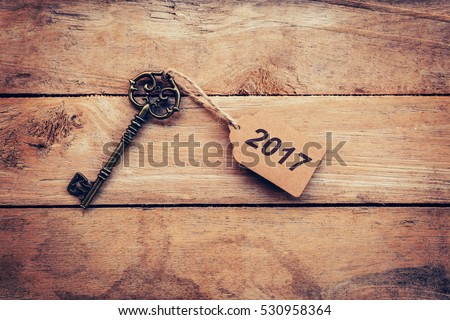 Business concept - Old key vintage on wood with tag 2017.